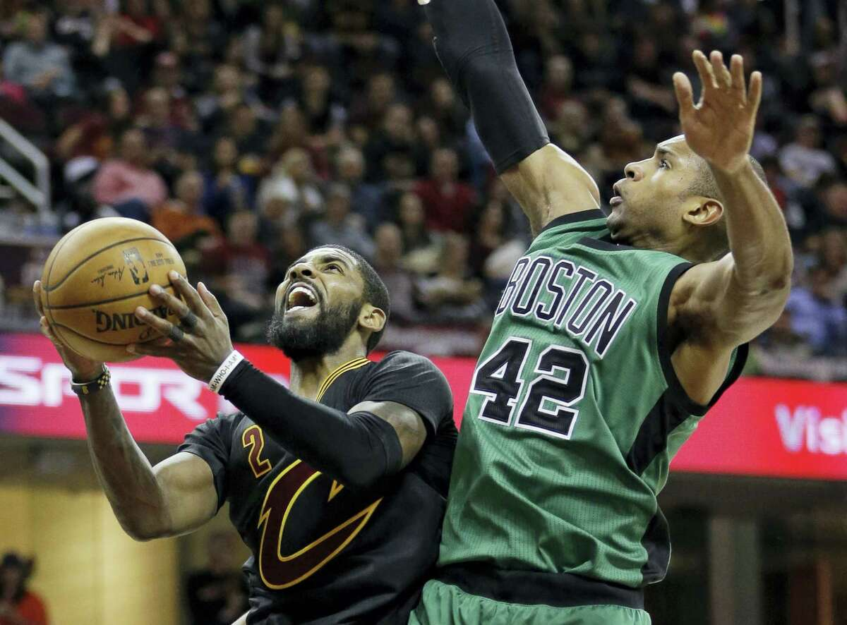 ASSOCIATED PRESS FILE PHOTO In this Dec. 29, 2016, file photo, Cleveland's Kyrie Irving, left, drives to the basket against Boston's Al Horford in the second half of an NBA regular season game. James and the defending champion Cavaliers will travel to face the top-seeded Celtics in Game 1 of the Eastern Conference finals.