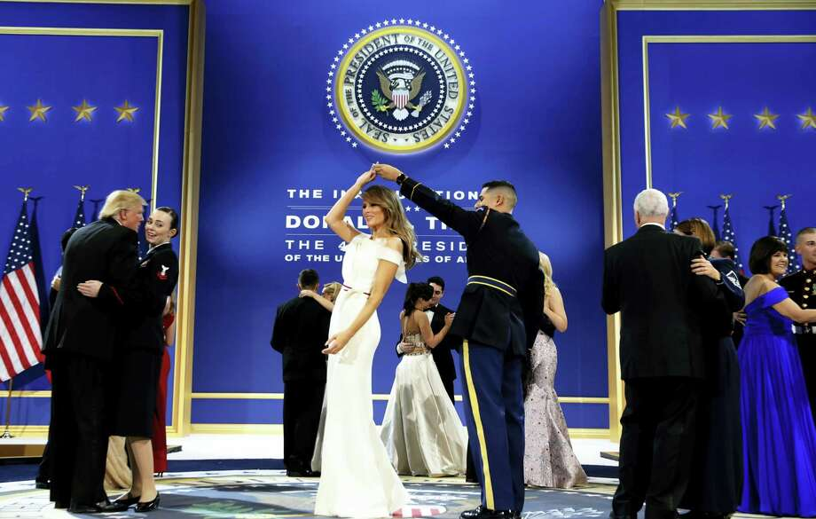 President Donald Trump, left, dances with Navy Petty Officer 2nd Class Catherine Cartmell as first lady Melania Trump is spun by Army Staff Sgt. Jose A. Medina during a dance at The Salute To Our Armed Services Inaugural Ball in Washington, Friday, Jan. 20, 2017. Photo: Alex Brandon — AP Photo  / Copyright 2017 The Associated Press. All rights reserved.