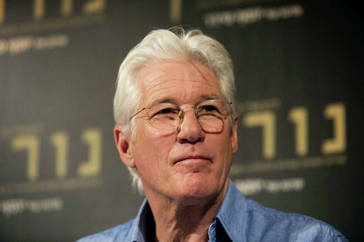 """American actor Richard Gere speaks during a press conference at the Israeli premiere of the """"Norman: The Moderate Rise and Tragic Fall of a New York Fixer"""" movie, in Jerusalem on March 9, 2017."""