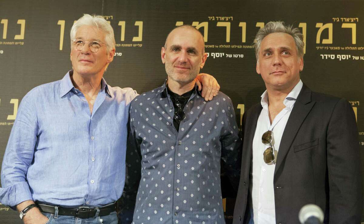 """American actor Richard Gere, left, movie director Joseph Cedar, center, and Israeli actor Lior Ashkenazi, stand for a photo before a press at then premiere of the """"Norman: The Moderate Rise and Tragic Fall of a New York Fixer"""" movie in Jerusalem on March 9, 2017."""