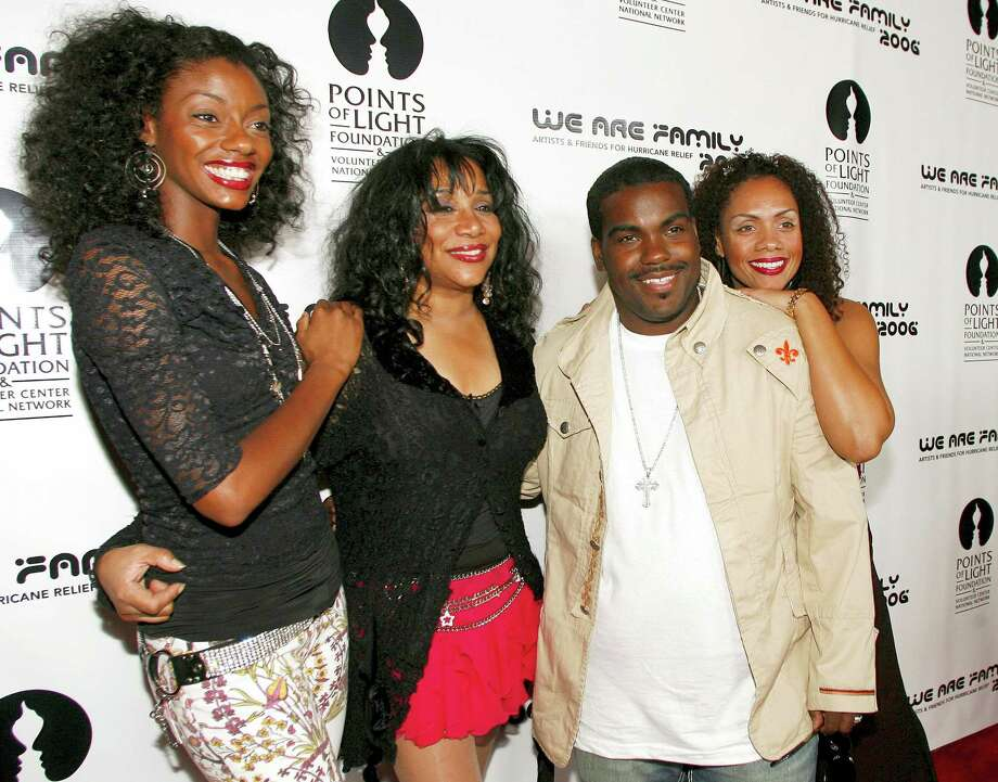 """This Aug. 14, 2006 photo shows Joni Sledge, one of the original members of """"Sister Sledge,"""" second from left, posing with Rodney Jerkins, second from right, her niece Camille Sledge, left, and her cousin Amber Sledge at the """"We Are Family 2006 — All-Star Katrina Benefit CD and Documentary DVD Launch"""" in Century City, Calif. Sledge, who with her sisters recorded the defining dance anthem """"We Are Family,"""" has died, the band's representative says. She was 60. Photo: AP Photo — Chris Polk, File  / AP2006"""