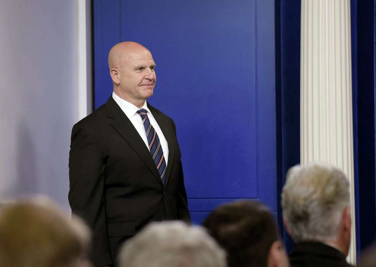 """National Security Adviser H.R. McMaster listens as he is introduced by White House press secretary Sean Spicer to speak at a briefing at the White House in Washington, Tuesday, May 16, 2017. President Donald Trump claimed the authority to share """"facts pertaining to terrorism"""" and airline safety with Russia, saying in a pair of tweets he has """"an absolute right"""" as president to do so."""