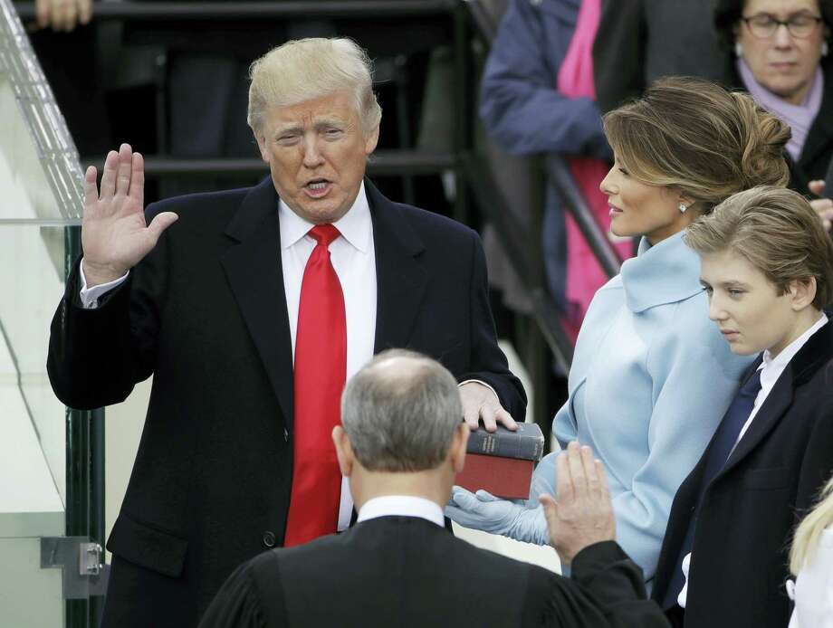 Donald Trump is sworn in as the 45th president of the United States by Chief Justice John Roberts as Melania Trump looks on during the 58th Presidential Inauguration at the U.S. Capitol in Washington Friday. Photo: The Associated Press  / Copyright 2017 The Associated Press. All rights reserved.
