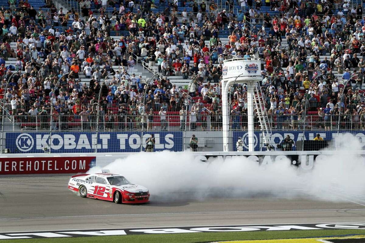 Joey Logano does a burnout after winning the Xfinity Series race at Las Vegas Motor Speedway on Saturday.