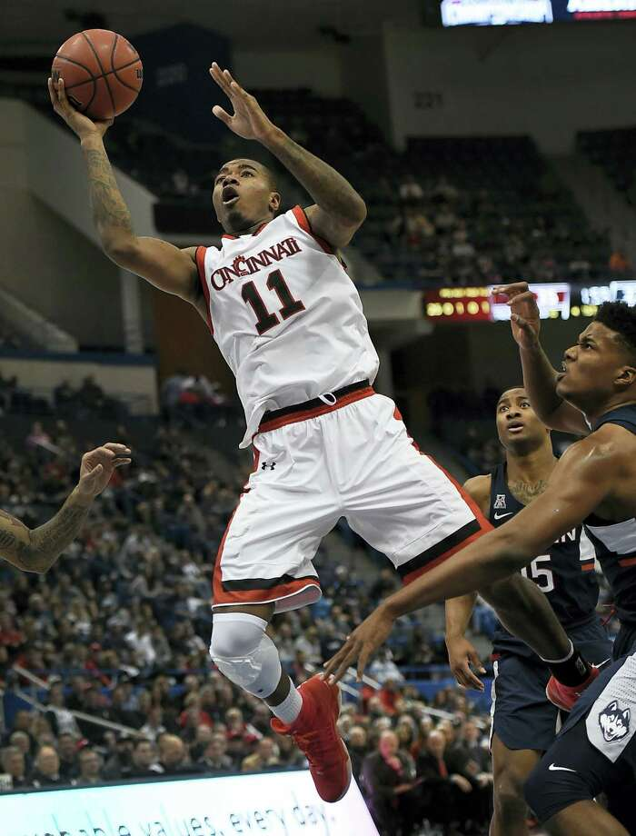 Cincinnati's Gary Clark, shoots as UConn's Vance Jackson, right, defends during the first half Saturday. Photo: Jessica Hill — The Associated Press  / AP2017