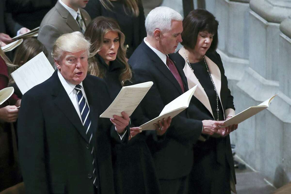 From left, President Donald Trump, first lady Melania Trump, Vice President Mike Pence and his wife Karen, sing together during a National Prayer Service at the National Cathedral in Washington on Saturday.