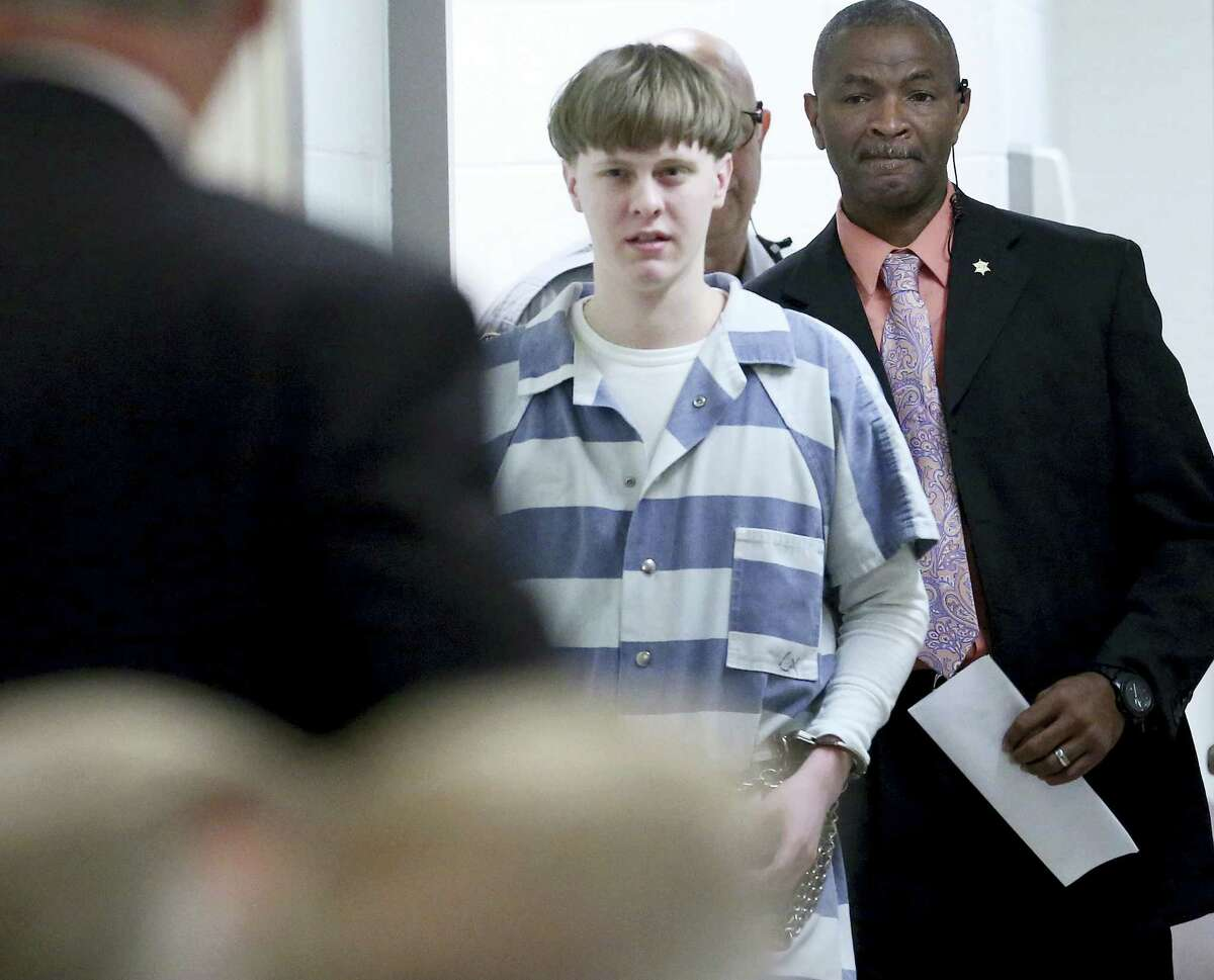 In this Monday, April 10, 2017, file photo, Dylann Roof enters the court room at the Charleston County Judicial Center to enter his guilty plea on murder charges in Charleston, S.C. Federal officials are for the first time showing videos of convicted the South Carolina church shooter's jailhouse visits with his family on Tuesday, May 16.