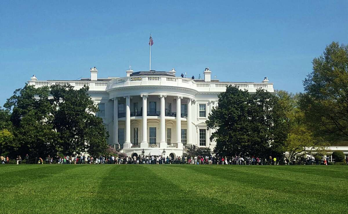 In this April 17, 2016, file photo, people visit the south lawn during the annual White House Spring Garden tours in Washington. The U.S. Secret Service says a person is under arrest after climbing a fence and getting onto the south grounds of the White House. The breach happened at about 11:38 p.m. Friday, March 10, 2017. President Donald Trump was at the White House.
