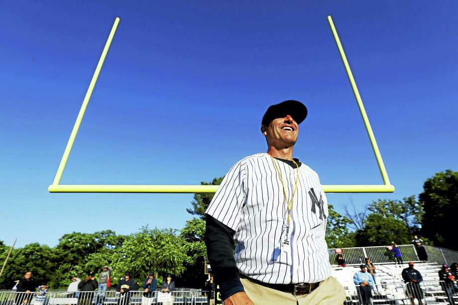 Michigan coach Jim Harbaugh walks on the field during the Next Level Football Camp at Paramus Catholic High School in Paramus, N.J. Photo: Julio Cortez — The Associated Press  / Copyright 2016 The Associated Press. All rights reserved. This material may not be published, broadcast, rewritten or redistribu