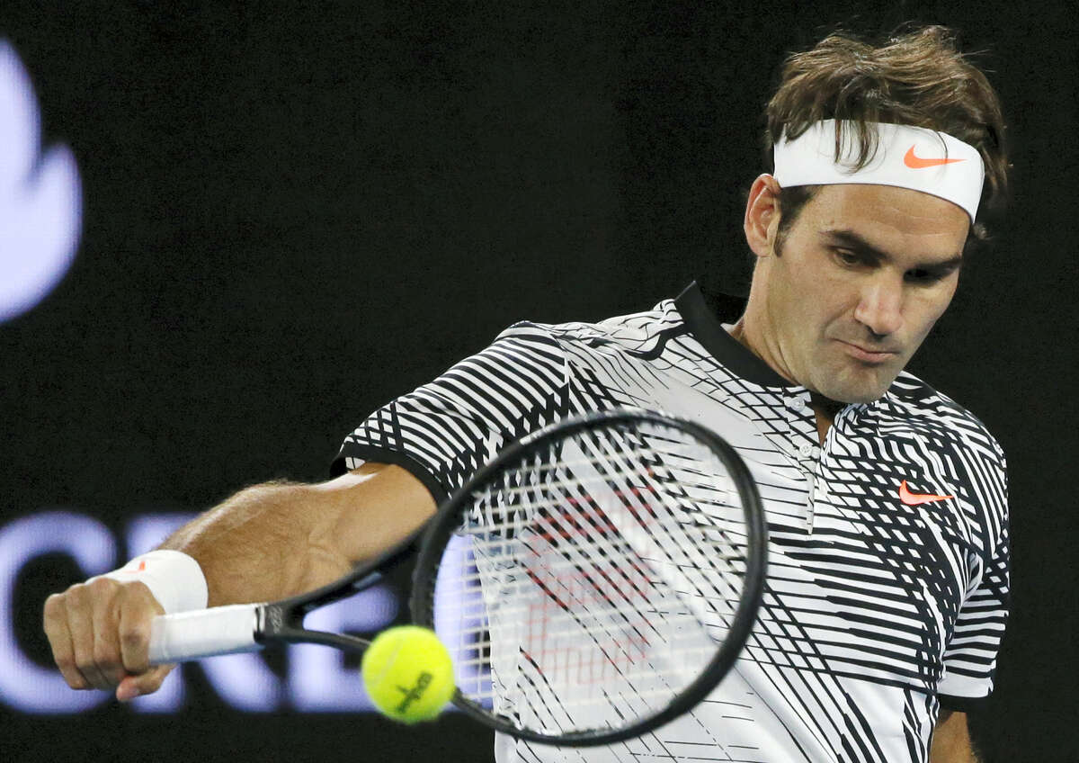 Roger Federer makes a backhand return to Tomas Berdych during their third-round match at the Australian Open on Friday.