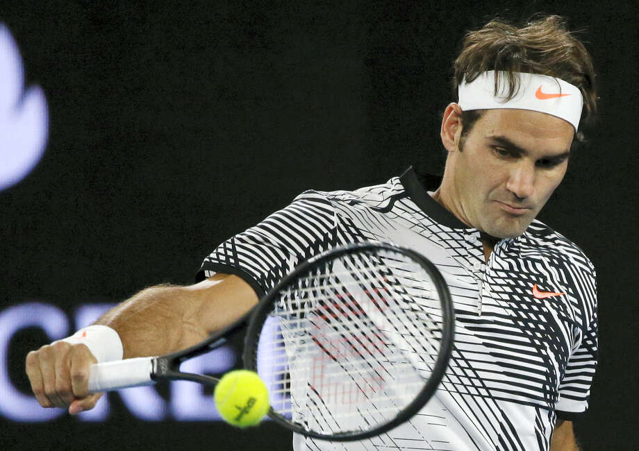 Roger Federer makes a backhand return to Tomas Berdych during their third-round match at the Australian Open on Friday. Photo: Dita Alangkara — The Associated Press  / Copyright 2017 The Associated Press. All rights reserved.