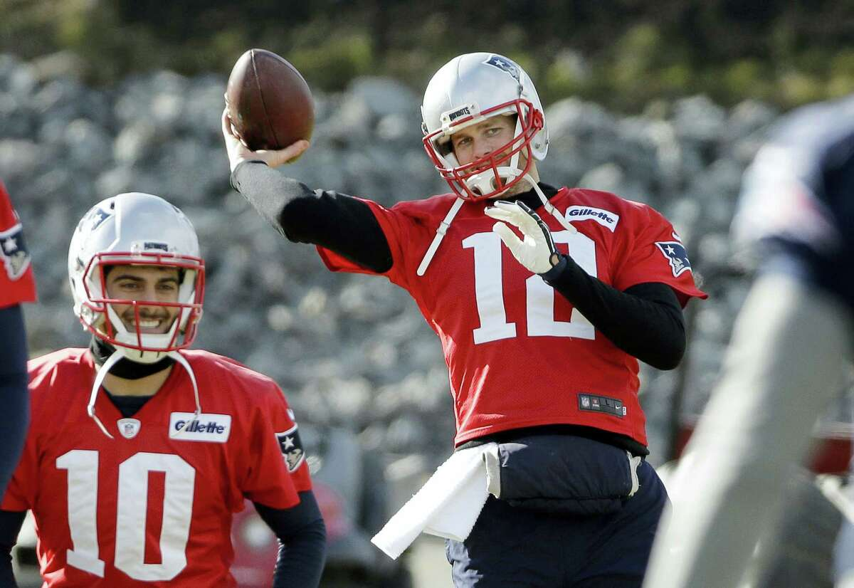 Patriots quarterback Tom Brady (12) winds up to throw the ball during a recent practice.