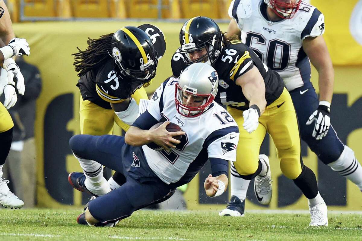 Tom Brady is sacked by Steelers linebackers Jarvis Jones (95) and Anthony Chickillo (56) during a game this past October.