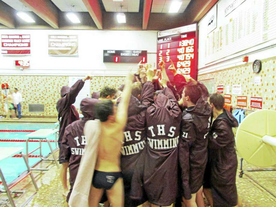 Torrington's boys swimming team took on NVL leader Holy Cross Friday night at the Torrington YMCA. Photo: Photo By Peter Wallace