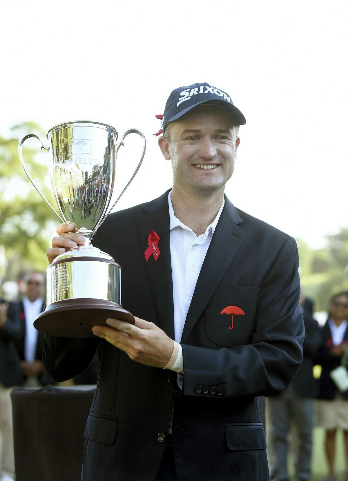 Russell Knox holds the trophy after winning the Travelers Championship golf tournament last August in Cromwell.
