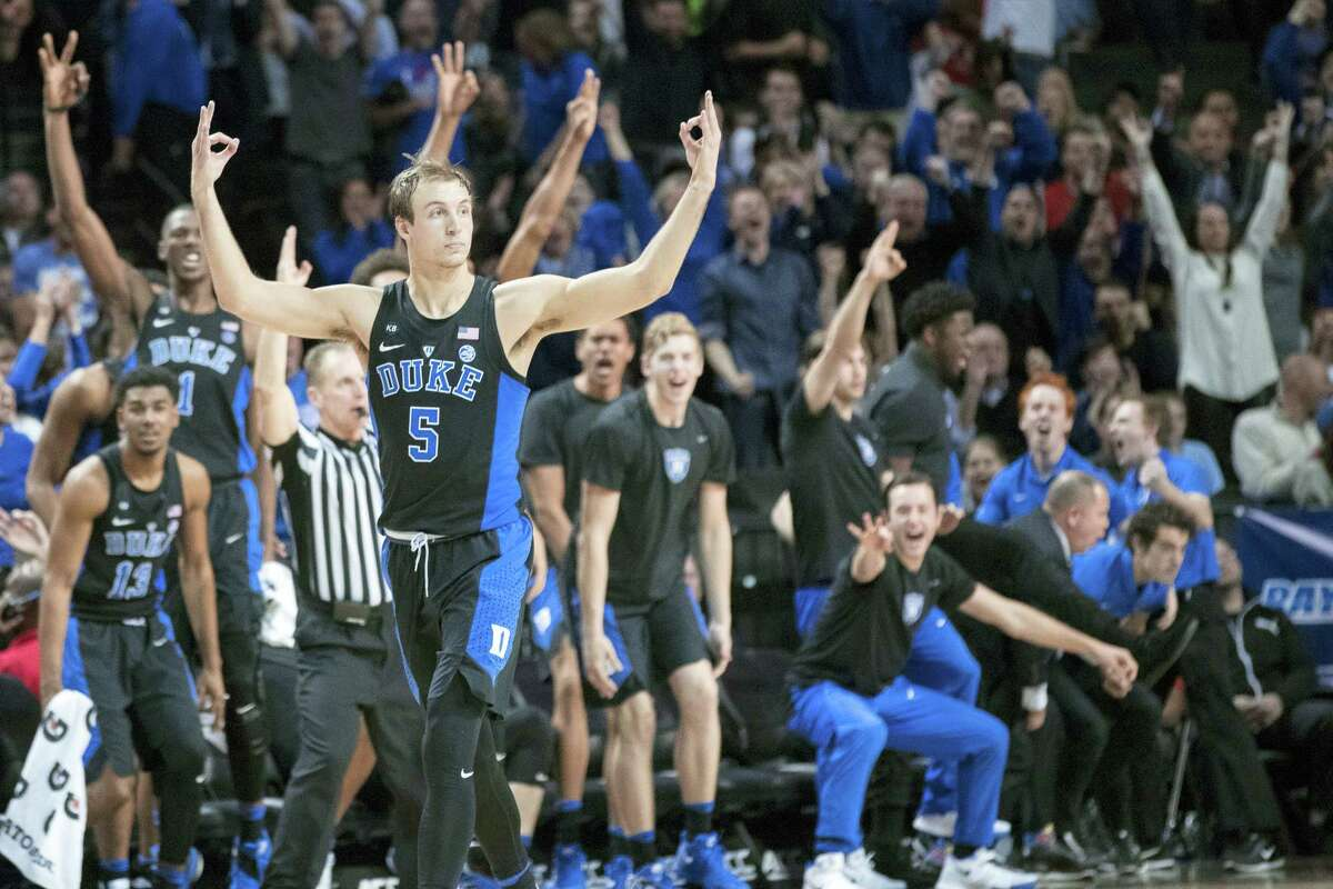 Duke guard Luke Kennard (5) reacts after scoring a 3-pointer during the second half of an NCAA college basketball game against Louisville in the Atlantic Coast Conference tournament, Thursday in New York. Duke won 81-77.