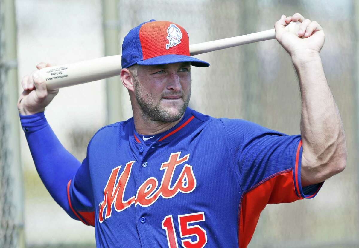 Tim Tebow stretches out before batting practice.