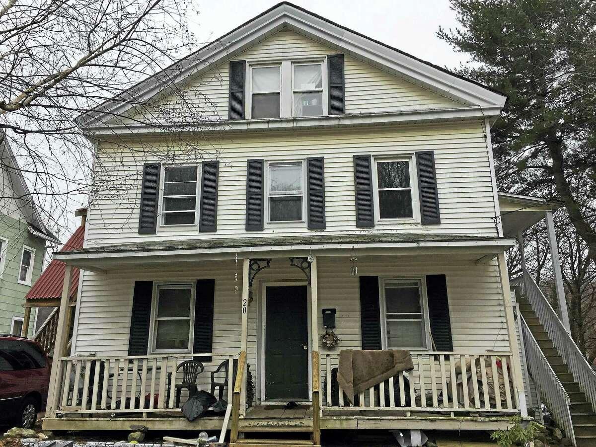 Ben Lambert — The Register Citizen A man was shot at this house on Rock Street.