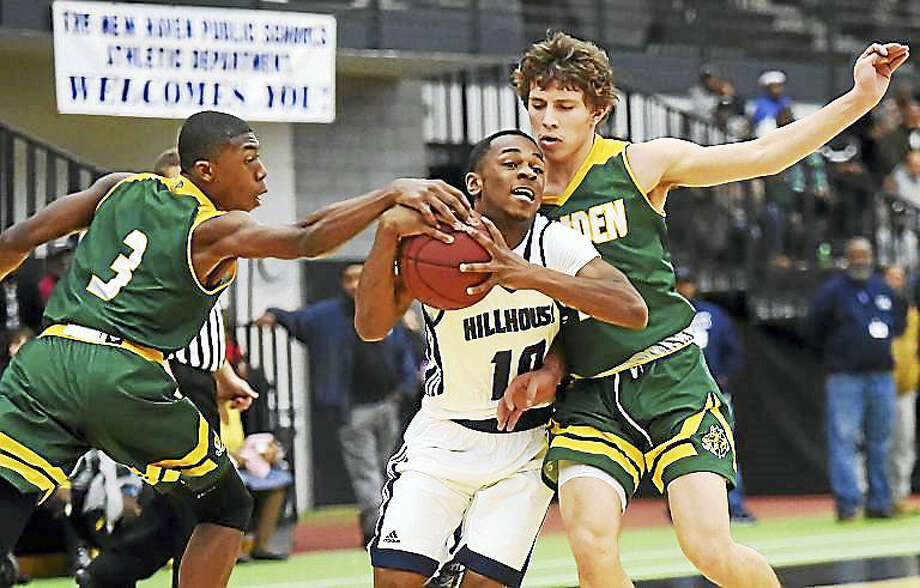 Hillhouse senior guard Jalil Wilkerson battled Hamden senior guard CJ Seaforth and Hamden sophomore guard Victor Rosario to the paint Thursday as the Academics defeated the Green Dragons, 62 – 58, at the Floyd Little Athletic Center in New Haven. Photo: Catherine Avalone — New Haven Register