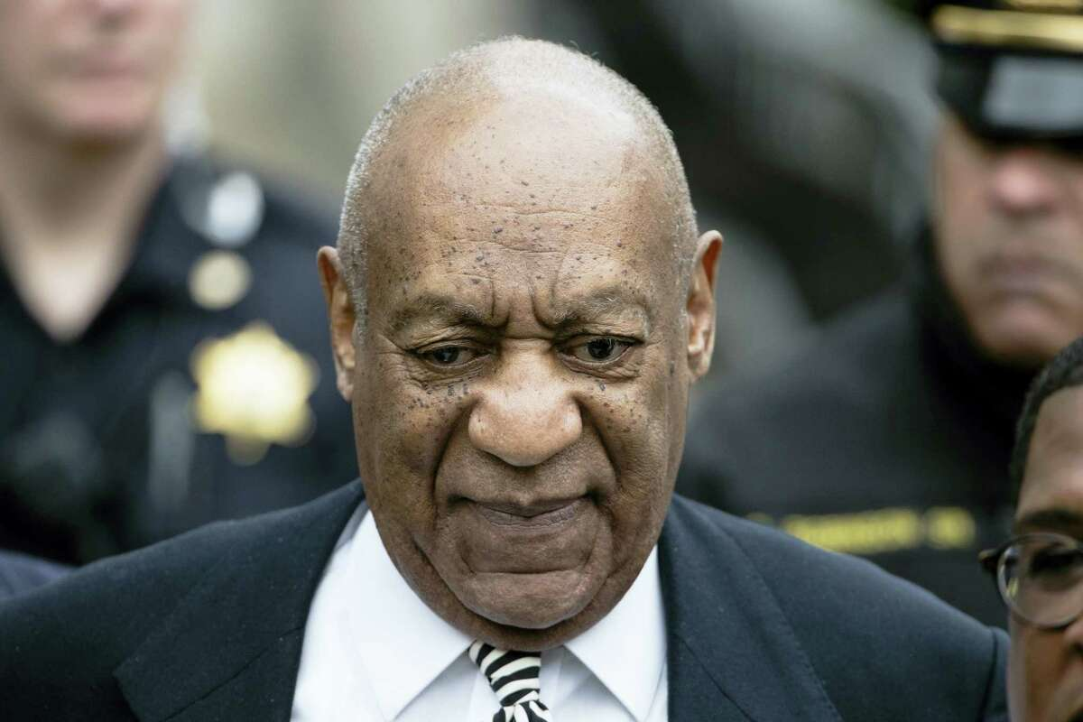 In this April 3, 2017, file photo, Bill Cosby departs after a pretrial hearing in his sexual assault case at the Montgomery County Courthouse in Norristown, Pa. Cosby says he doesn't expect to testify at his Pennsylvania sexual assault trial. spoke to Sirius radio host Michael Smerconish in an interview being broadcast Tuesday. Smerconish says he agreed to air excerpts of the 82-minute conversation between Cosby and his daughters in exchange for the interview.