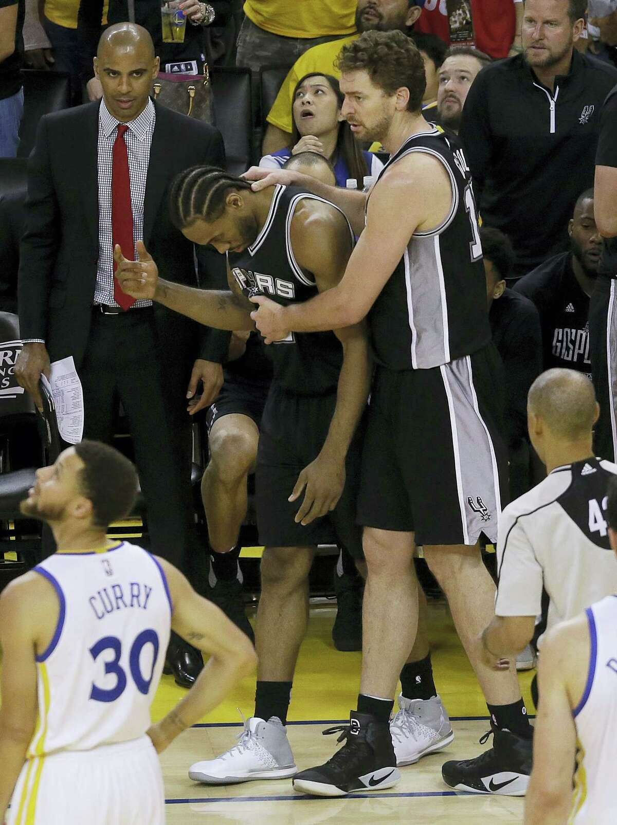 San Antonio Spurs forward Kawhi Leonard, center left, gestures next to center Pau Gasol during the second half of Game 1 of the NBA basketball Western Conference finals against the Golden State Warriors in Oakland, Calif. on May 14, 2017. The Warriors won 113-111.