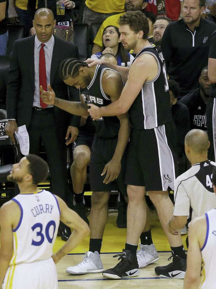 San Antonio Spurs forward Kawhi Leonard, center left, gestures next to center Pau Gasol during the second half of Game 1 of the NBA basketball Western Conference finals against the Golden State Warriors in Oakland, Calif. on May 14, 2017. The Warriors won 113-111. Photo: AP Photo — Jeff Chiu  / Copyright 2017 The Associated Press. All rights reserved.