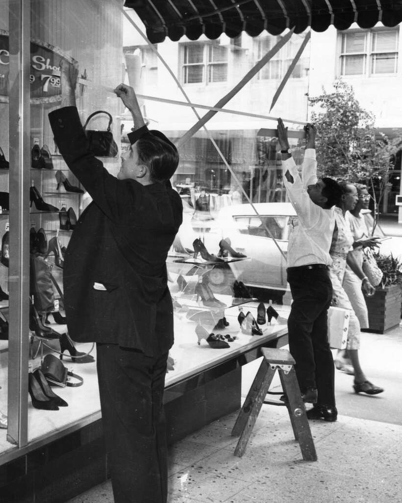 Shopkeepers tape windows downtown ahead of Hurricane Carla's arrival, 1961. Photo: Houston Chronicle