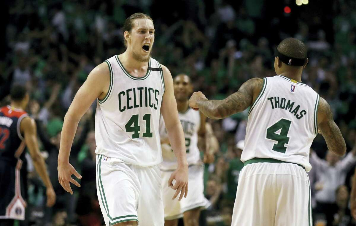 Celtics center Kelly Olynyk (41) celebrates with Isaiah Thomas during the fourth quarter on Monday's win over the Wizards in Game 7.