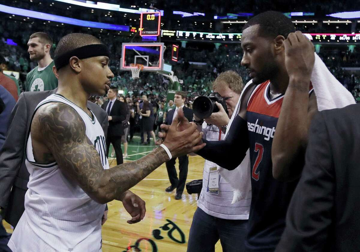 Celtics guard Isaiah Thomas, left, and Wizards guard John Wall speak on the court after Monday's game.