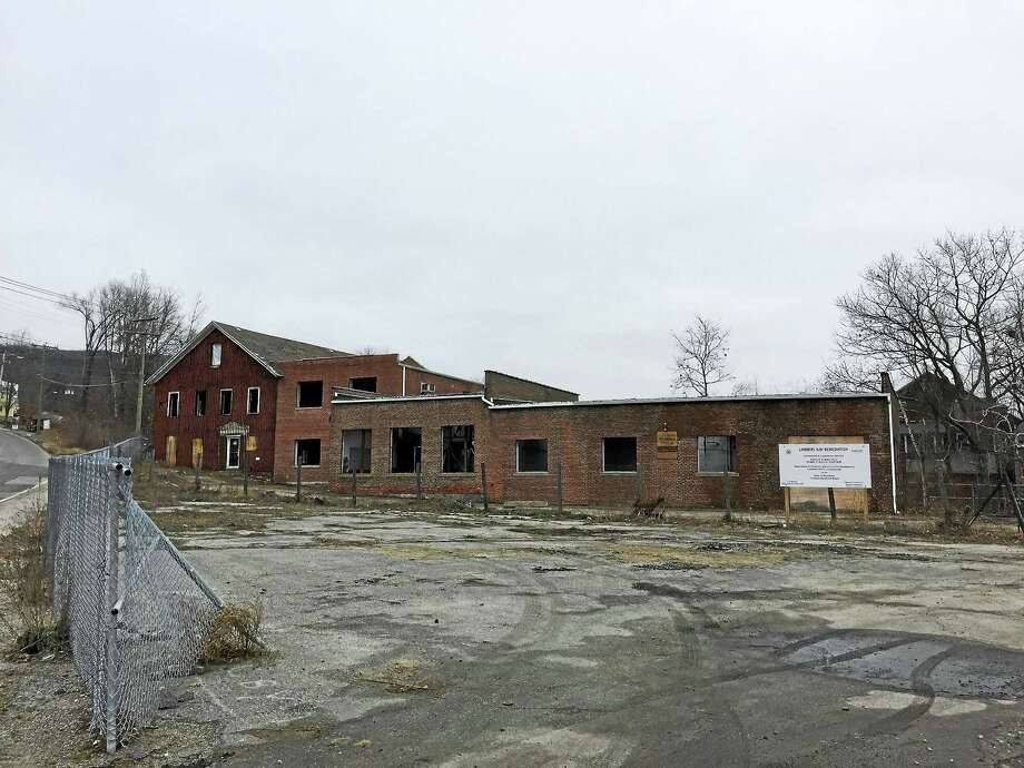 The remediation of the Lambert Kay building and property is nearly complete, and town officials are hoping to eventually find a buyer. If they don't, the building could be demolished. Photo: Ben Lambert — The Register Citizen