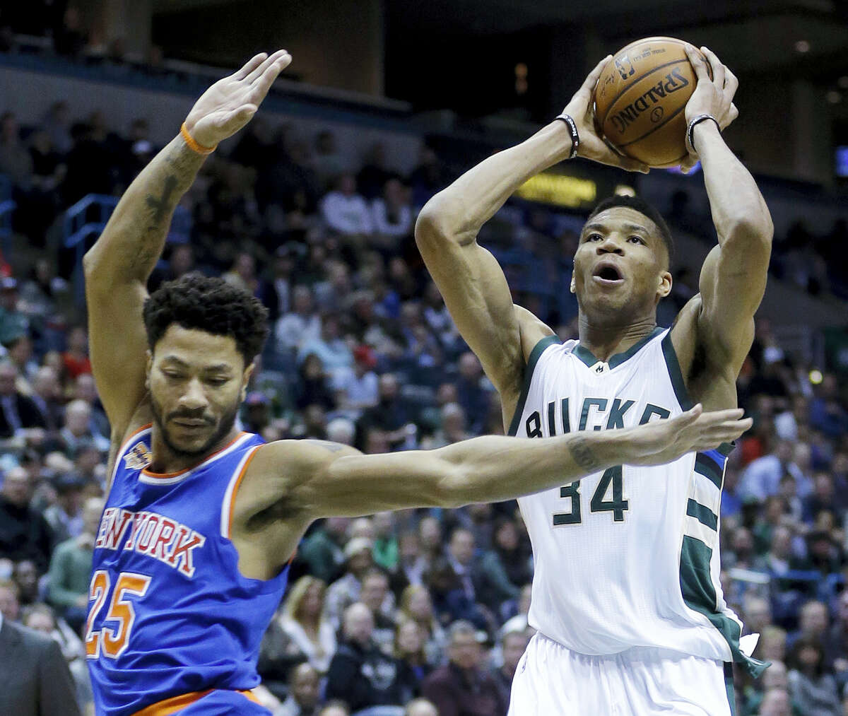 Milwaukee Bucks' Giannis Antetokounmpo (34) drives past New York Knicks' Derrick Rose (25) during the second half of an NBA basketball game March 8, 2017 in Milwaukee.
