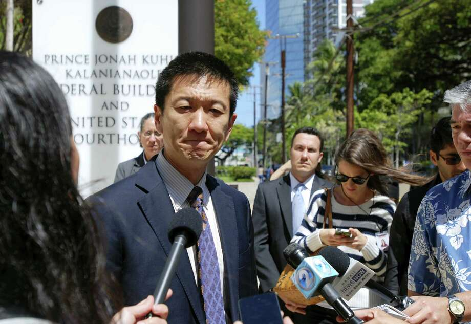 In this March 29, 2017 photo, Hawaii Attorney General Douglas Chin speaks outside federal court in Honolulu, Hawaii. Three federal appellate court judges in Seattle on May 15, 2017 will hear the appeal of Hawaii's challenge to President Trump's travel ban targeting six predominantly Muslim countries. Photo: AP Photo — Caleb Jones, File  / Copyright 2017 The Associated Press. All rights reserved.
