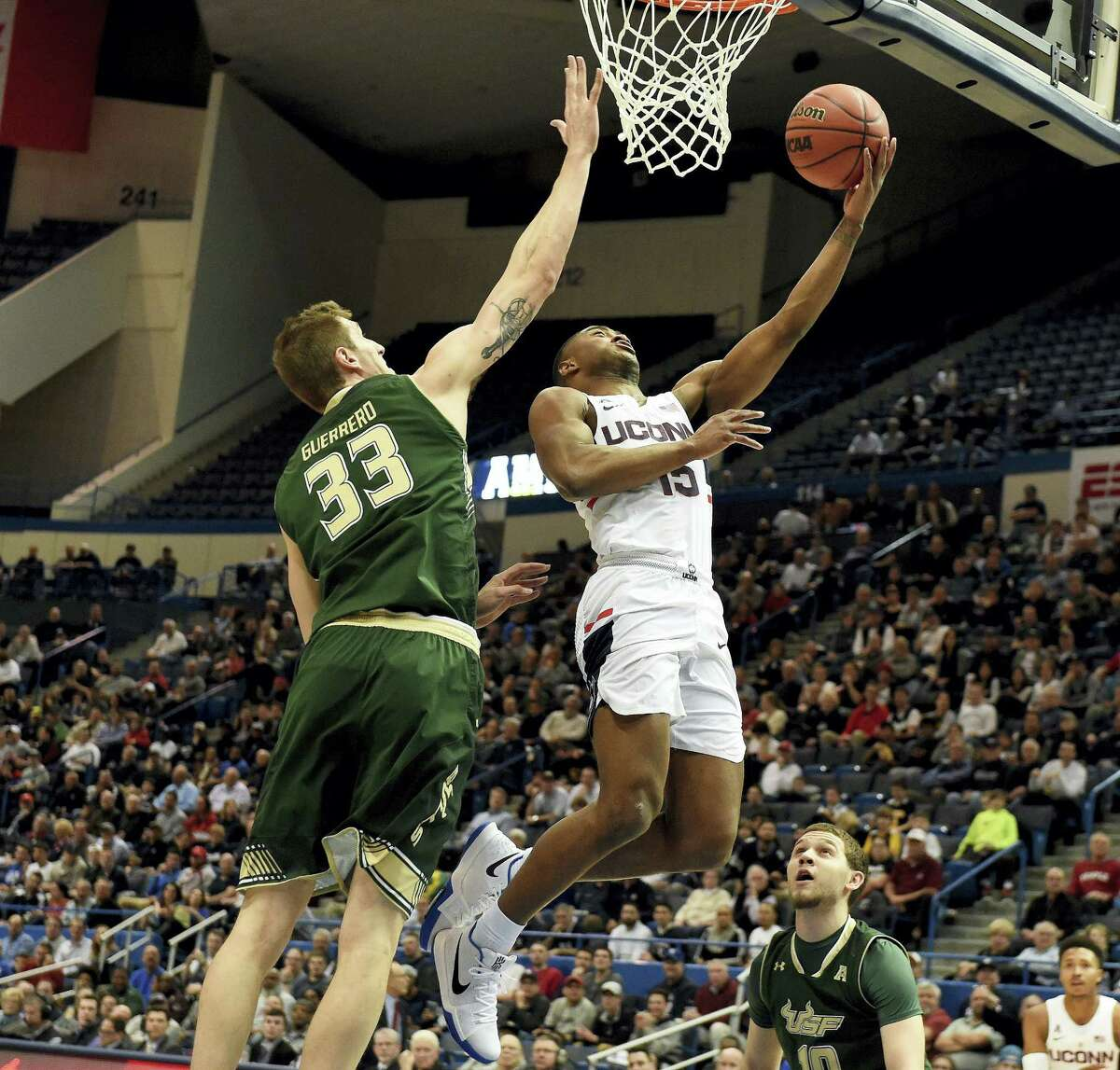 UConn's Rodney Purvis goes up for a basket against South Florida's Ruben Guerrero during the first half of their AAC tournament game on Thursday in Hartford.