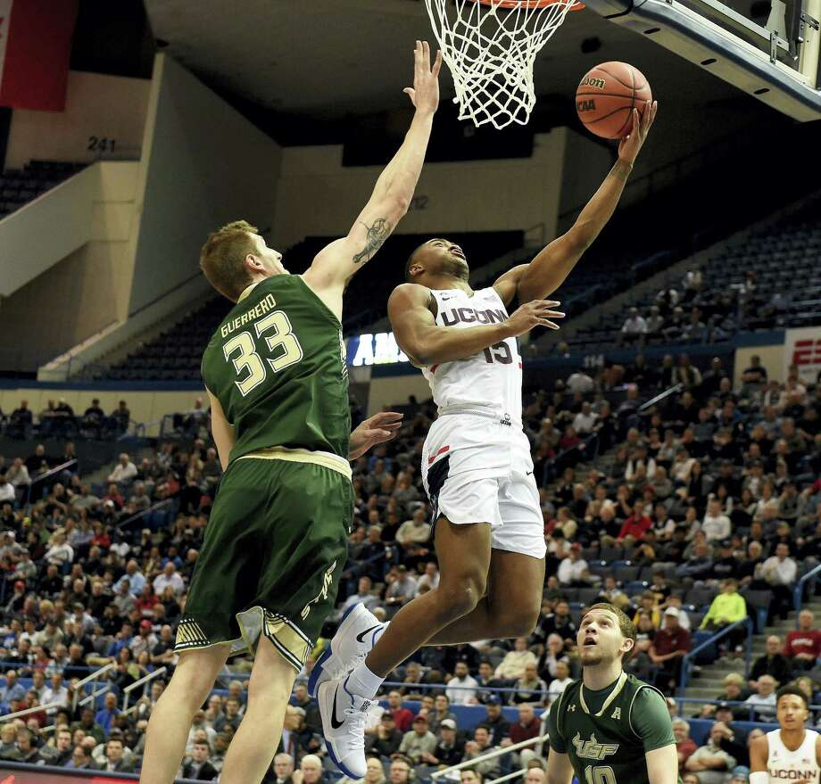 UConn's Rodney Purvis goes up for a basket against South Florida's Ruben Guerrero during the first half of their AAC tournament game on Thursday in Hartford. Photo: Jim Michaud — Journal Inquirer Via AP  / AP2017