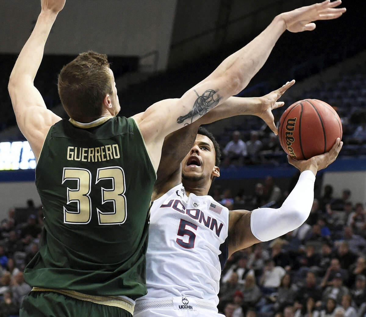 UConn's Vance Jackson is blocked by South Florida's Ruben Guerrero during the first half.