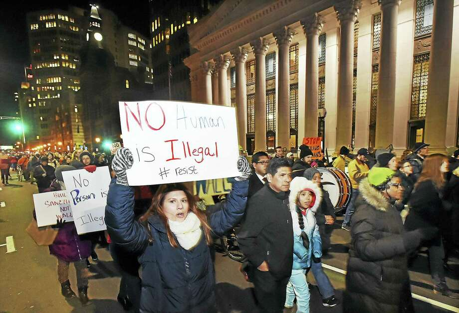 Hundreds of area residents march up Church Street in New Haven in January protesting President Donald J. Trump's policies on immigration and sanctuary cities. Photo: New Haven Register File Photo  / Catherine Avalone/New Haven Register