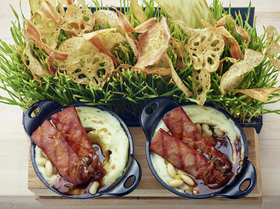 This St. Patrick's Day, make bangers and mash with buttermilk whipped potatoes and stout-onion gravy from scratch. Photo: Phil Mansfield — The Culinary Institute Of America Via AP  / © 2017 The Culinary Institute of America - Phil Mansfield