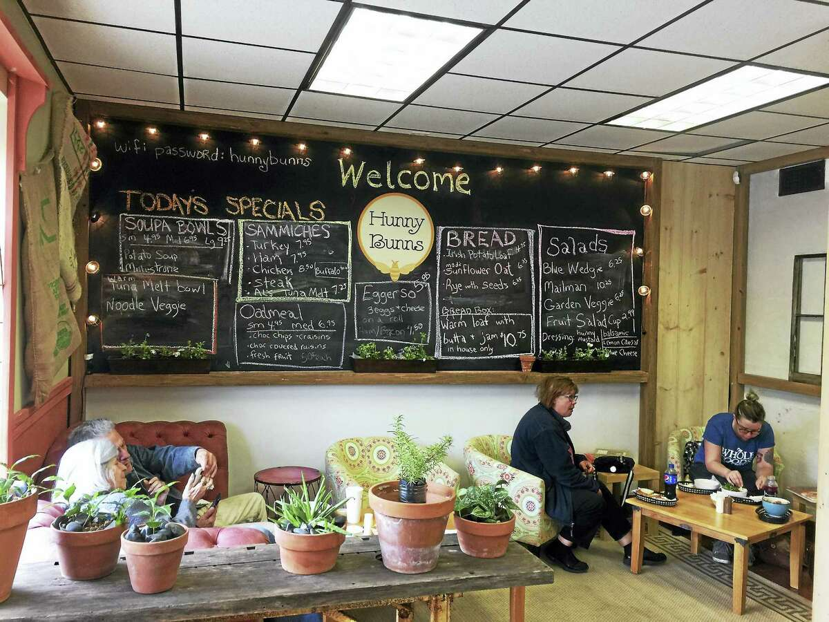 The Hunny Bunns Cafe & Bakery recently opened in downtown Winsted. Above, customers have lunch in a corner of the bakery.