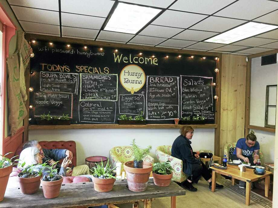 The Hunny Bunns Cafe & Bakery recently opened in downtown Winsted. Above, customers have lunch in a corner of the bakery. Photo: Ben Lambert —The Register Citizen