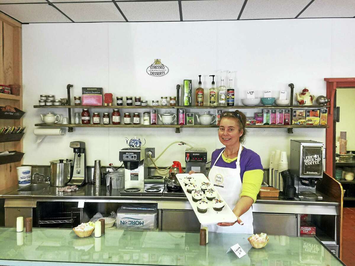 Wendy Scanlon, the owner of Hunny Bunns Cafe & Bakery, shows off a tray of her cupcakes Monday.
