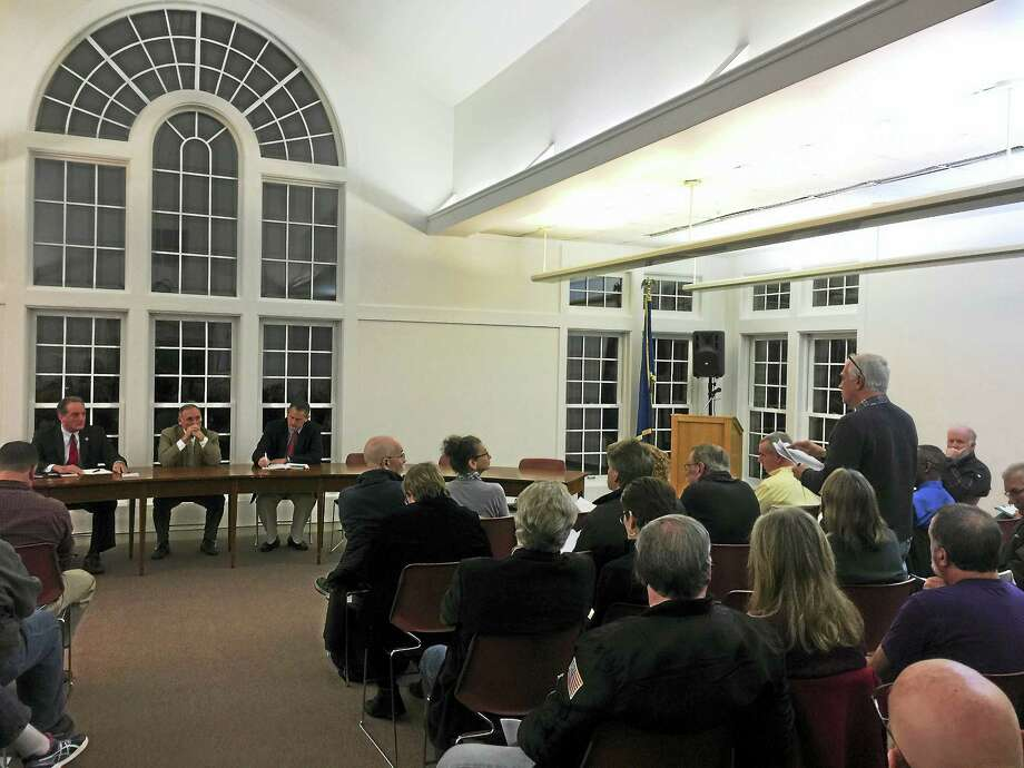 State Rep. John Piscopo (R-76th), Rep. Henri Martin (R-31st), and Sen. Kevin Witkos (R-8th) answered questions from residents at a packed town hall meeting in Harwinton Tuesday. Photo: Ben Lambert — The Register Citizen