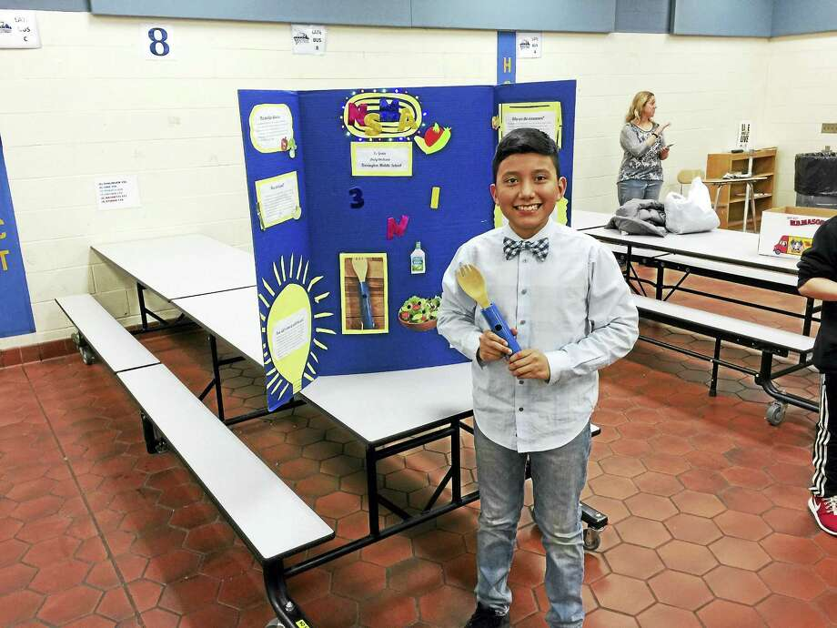 Andy Orellana shows his invention, a three-in-one salad topper, during the Invention Convention at Torrington Middle School. Photo: Ben Lambert — The Register Citizen