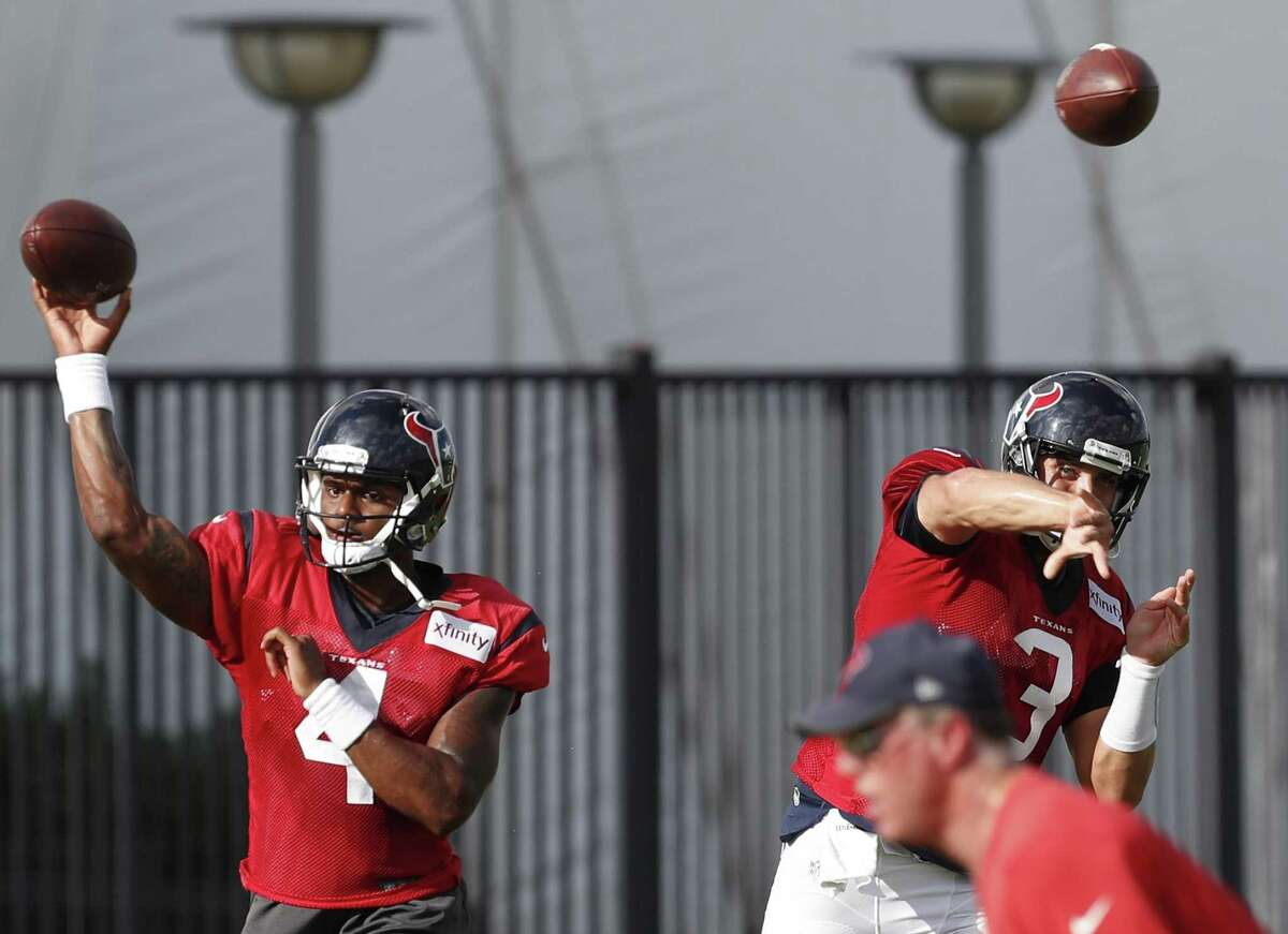 Texans quarterbacks Deshaun Watson (4) and Tom Savage (3) throw passes side by side during training camp at The Methodist Training Center on Aug. 22, 2017, in Houston.