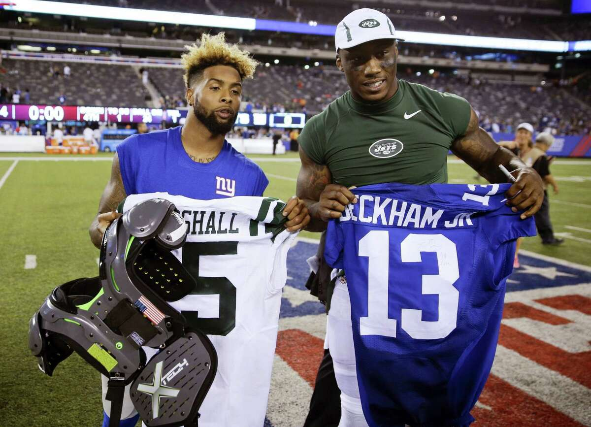 In this file photo, Giants wide receiver Odell Beckham, left, and Jets wide receiver Brandon Marshall, right, pose for photographs after exchanging jerseys after a preseason game. The Giants have signed free agent receiver Brandon Marshall to a two-year contact. The former Jets receiver tweeted a picture of the signed contact on Wednesday.