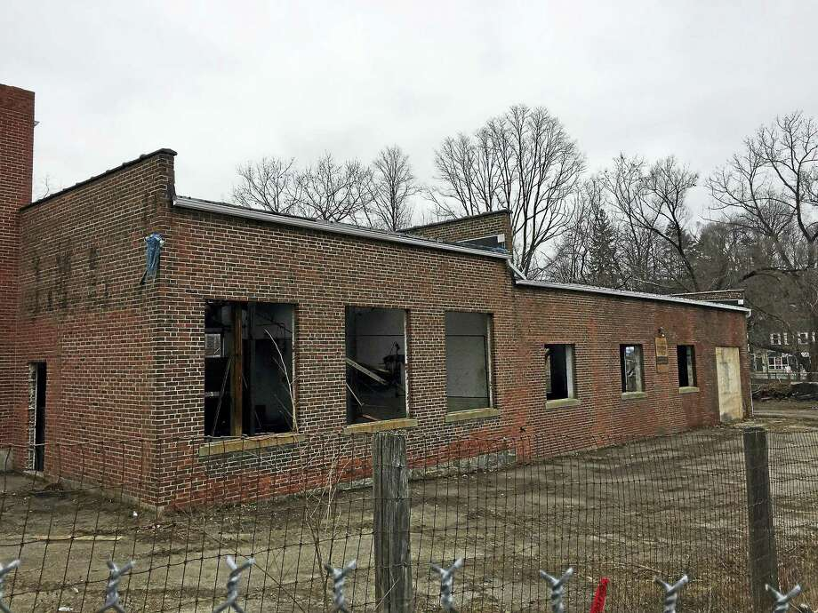 The town-owned Lambert Kay building and property in Winsted is undergoing an environmental cleanup. Winsted offficials say they've received a bid for the site, and are now evaluating that bidder before moving forward with any negotiation or sale. Photo: Ben Lambert — The Register Citizen