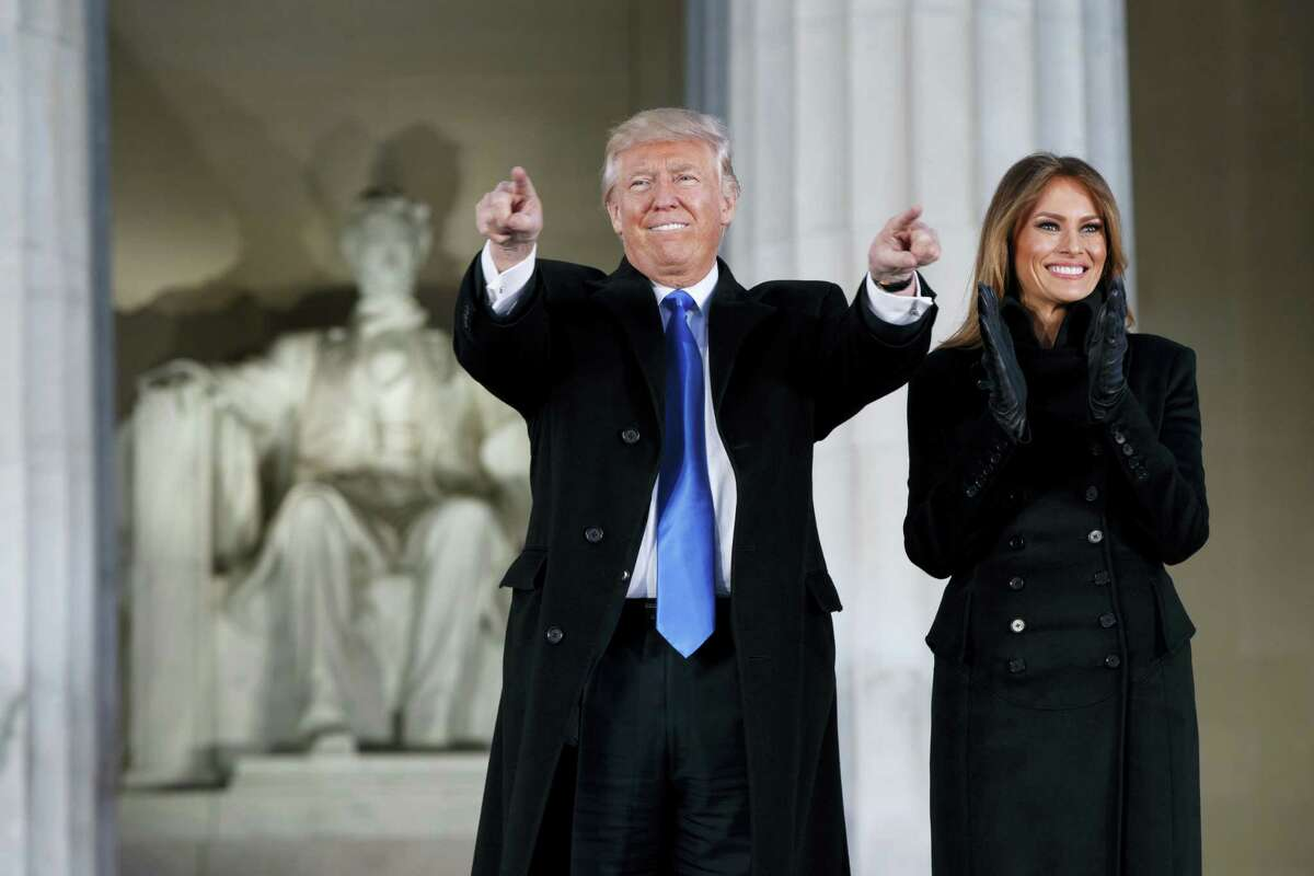 """President-elect Donald Trump, left, and his wife Melania Trump arrive to the """"Make America Great Again Welcome Concert"""" at the Lincoln Memorial, Thursday, Jan. 19, 2017, in Washington."""