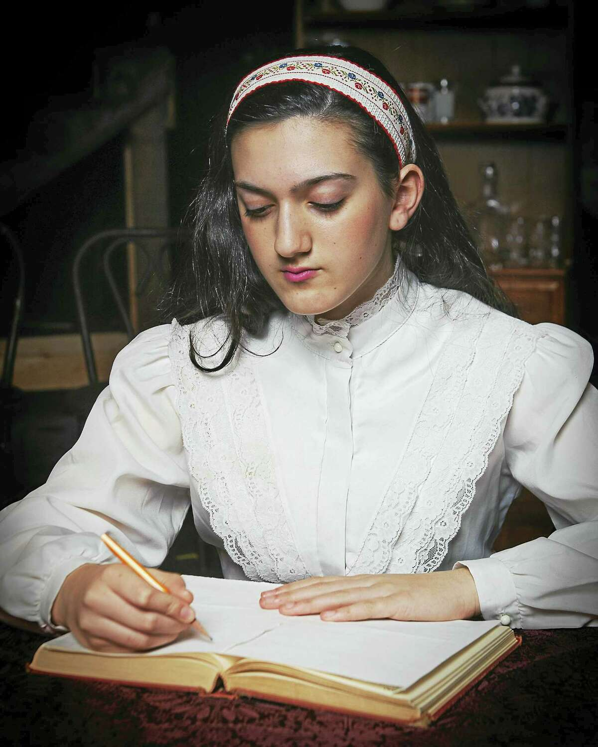 """Lexi White stars as Anne Frank in Landmark Community Theatre's production of """"The Diary of Anne Frank"""" opening March 17 at the Thomaston Opera House in Thomaston."""