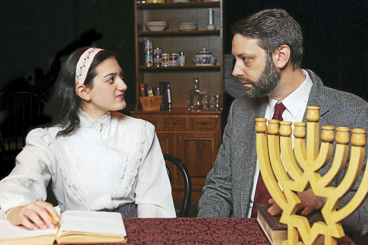 """Lexi White as Anne Frank and Johnny Revicki as Otto Frank, star in Landmark Community Theatre's production of """"The Diary of Anne Frank"""" opening March 17 at the Thomaston Opera House in Thomaston."""