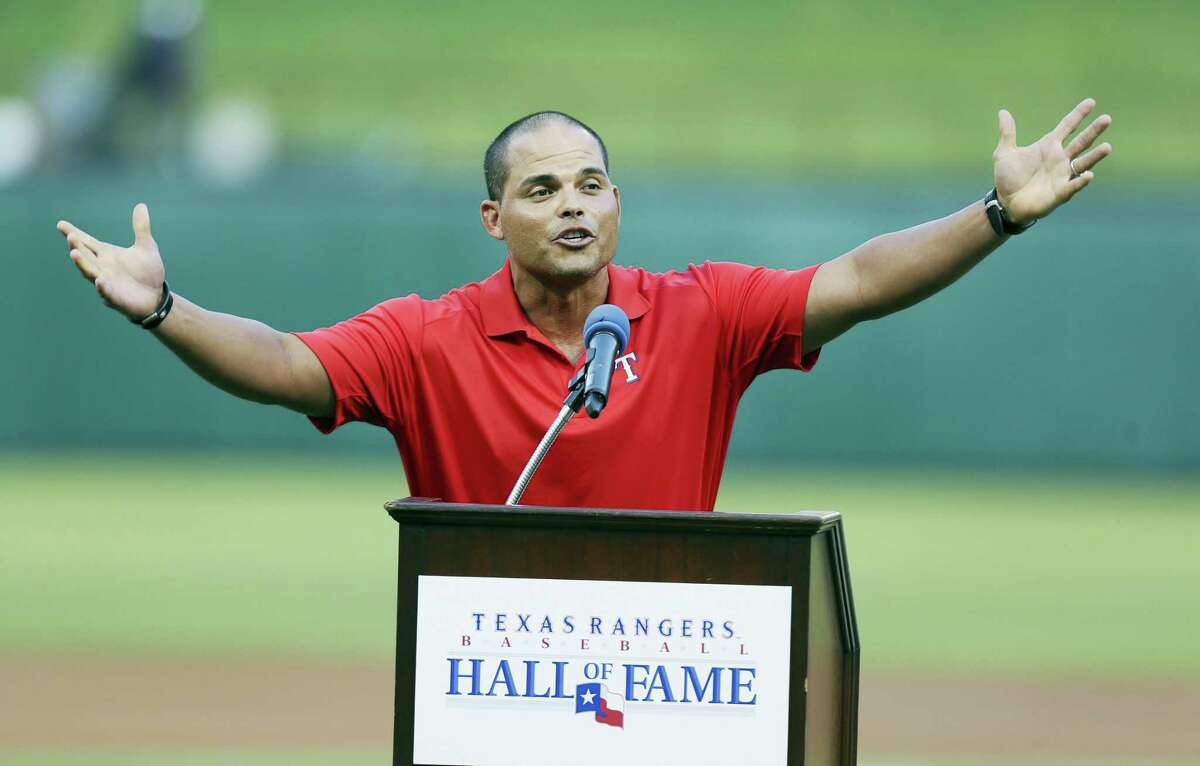 Former Texas Rangers and 14-time All-Star catcher Ivan Rodriguez speaks in 2013 after he was inducted into the Texas Rangers Baseball Hall of Fame before a baseball game between the Baltimore Orioles and the Rangers, in Arlington, Texas.