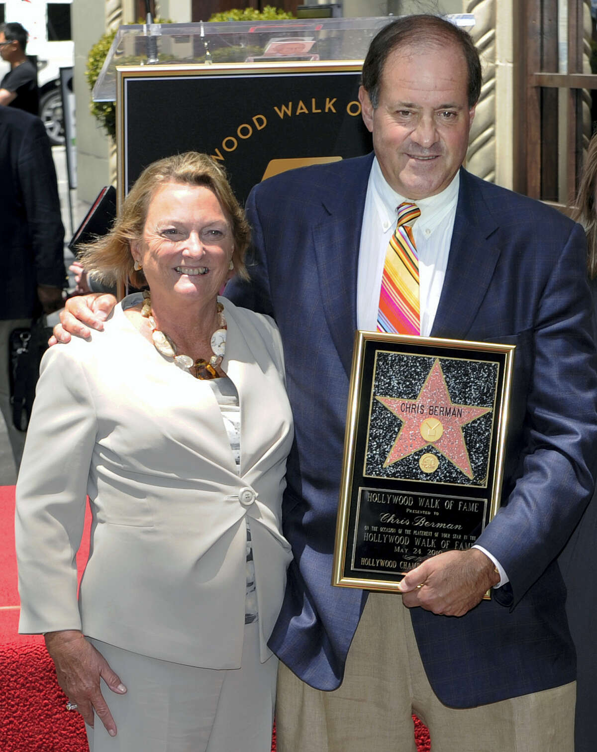In this May 24, 2010, photo provided by ESPN, sportscaster Chris Berman stands with his wife, Katherine, upon receiving his star on the Hollywood Walk of Fame in Los Angeles. Katherine Ann Berman, 67, a teacher, was one of two victims in a two-vehicle crash at about 2:15 p.m. on May 9, 2017 in Woodbury, state police said.